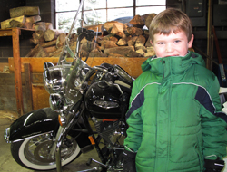 Ryan with Robert's Harley Davidson motorcycle